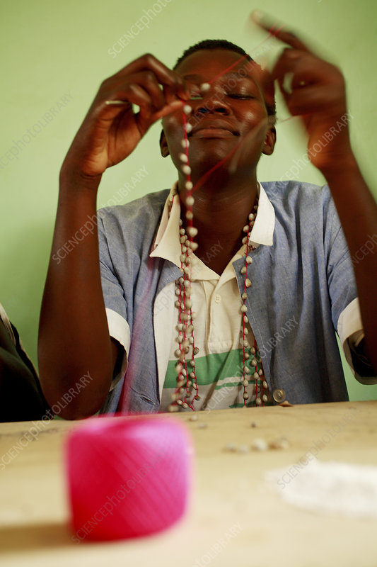 Making a necklace, Uganda