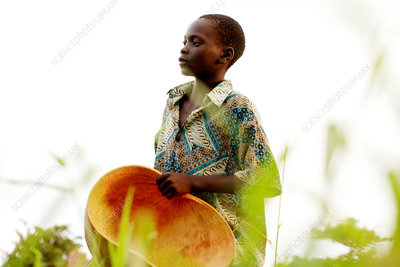 Child with an empty gourd, Uganda