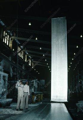 Aluminium ingot manipulated by an overhead crane