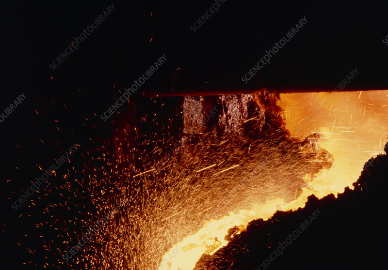 Molten iron being tapped from blast furnace
