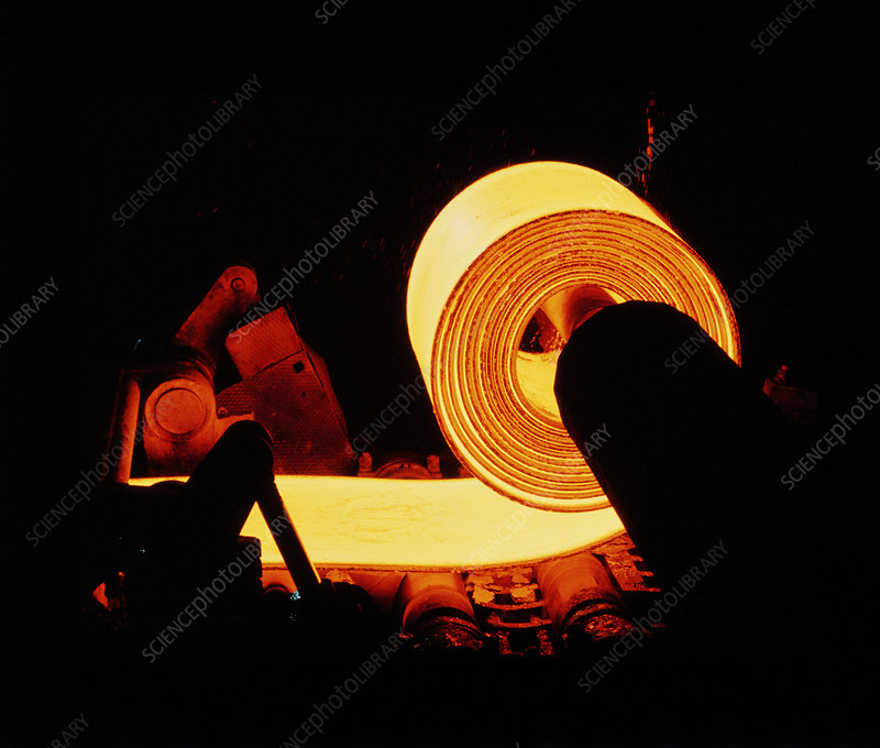 Red-hot coil of sheet steel in a rolling mill.