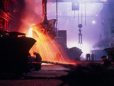 Sparks fly in a foundry during copper smelting