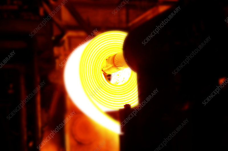 Rolling hot steel at a steel mill