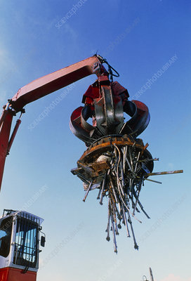 Large electromagnet in use at a scrapyard