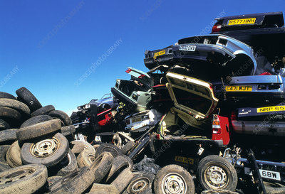 View of tyres and scrapped cars in a scrapyard