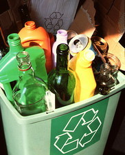 Glass, plastic and carboard in a recycling bin