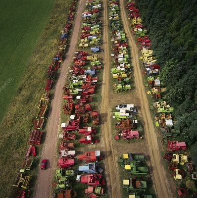Combine harvesters in a scrapyard