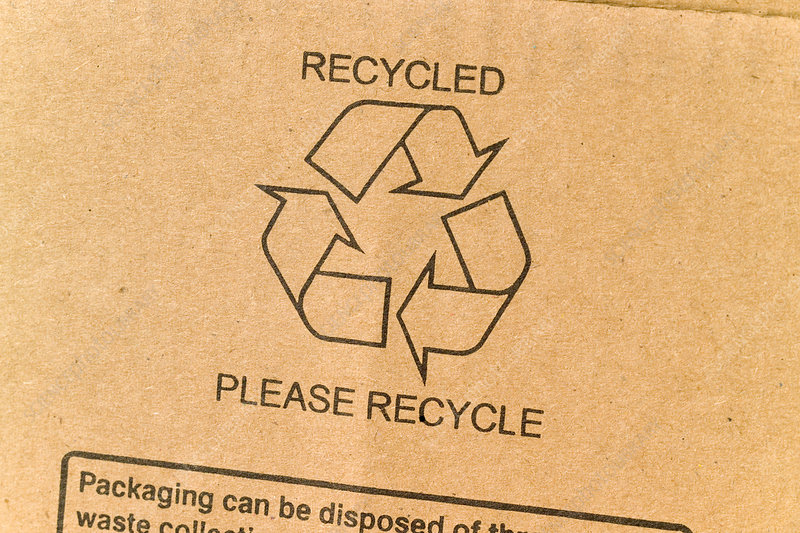 Recycling symbol on recycled cardboard
