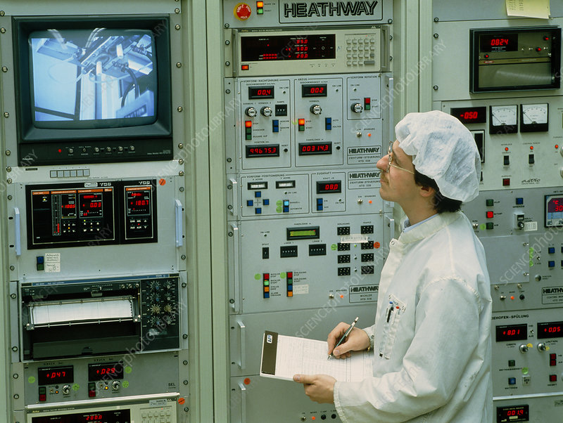 Worker & control panel in an optical fibre factory