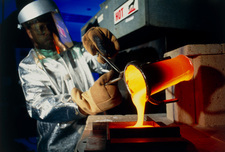Technician pours molten glass from a crucible