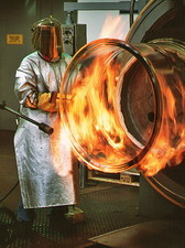 Glass technician manufacturing a large glass tube
