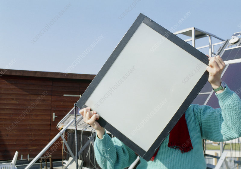 Woman holding an Interpane thermotrope window