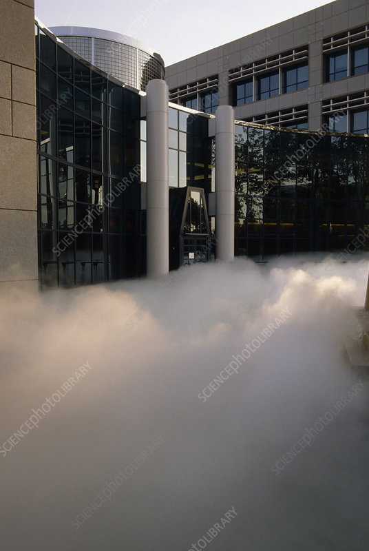Smoke effect at back of office block, USA