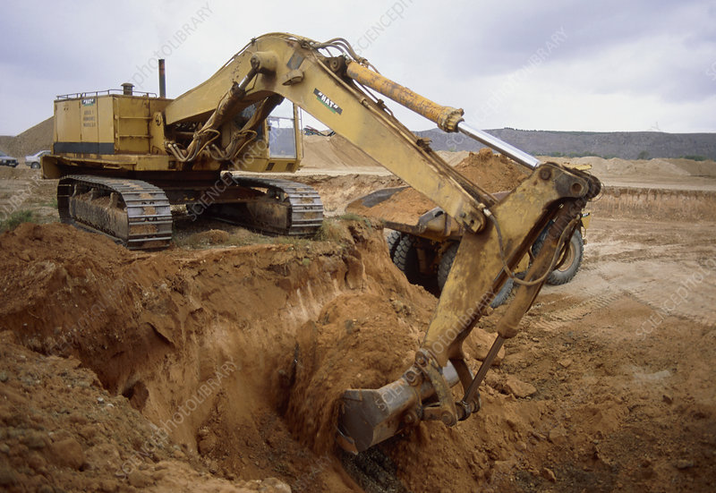 Earth-moving excavator in use