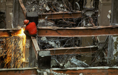 Construction worker demolishing a building