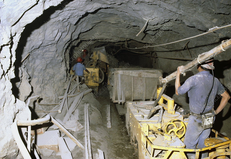 Removing debris by silver mine workers