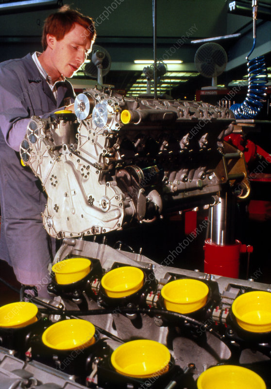 Technician with Renault Formula One engine