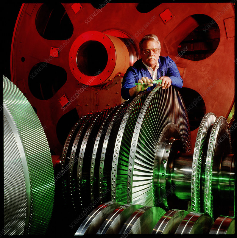 Engineer measuring part of a ship engine turbine