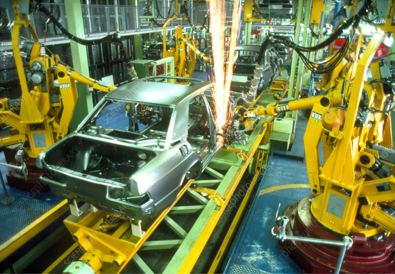 Robots welding in a car production line