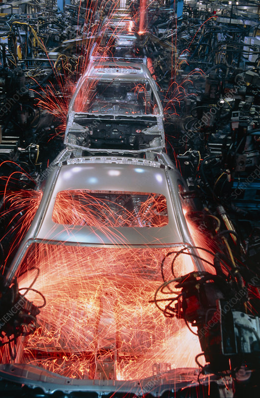 Robots welding in a car body production line