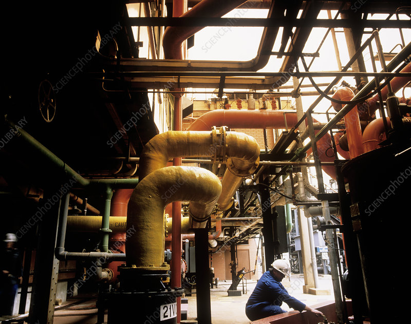 Pipes & worker at chlorine producing plant
