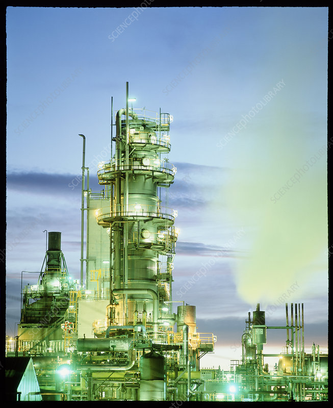 Reactor towers at a chemical plant at dusk