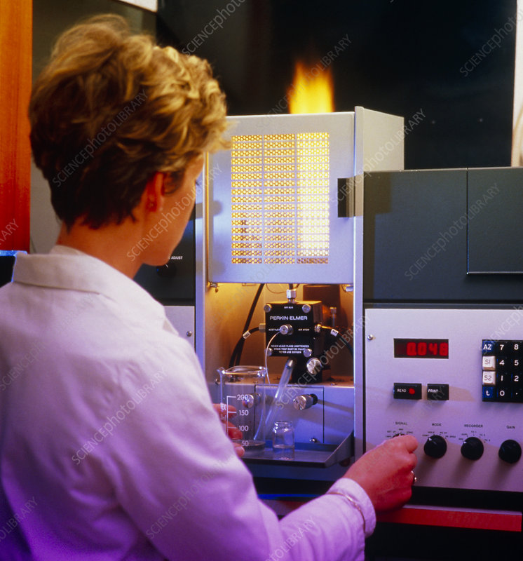 Analytical chemist using AA spectrometer