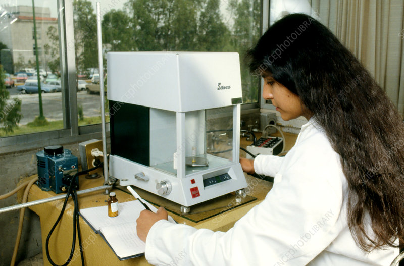 Chemist with laboratory scales