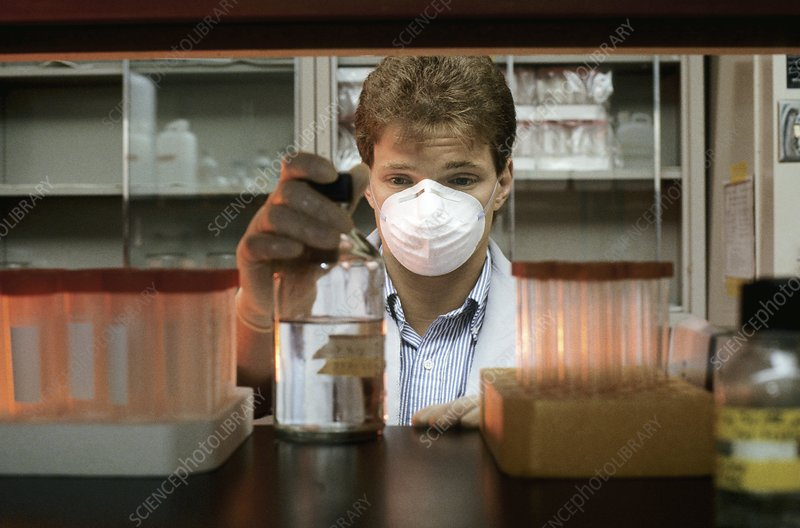 Laboratory researcher views a chemical solution