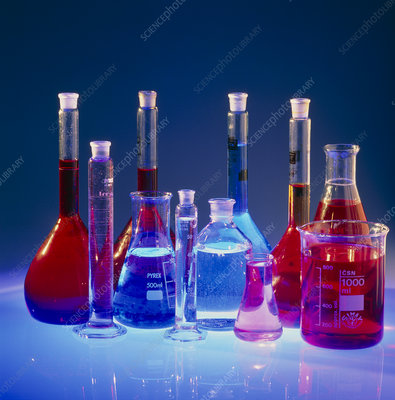 Laboratory flasks containing chemical solutions