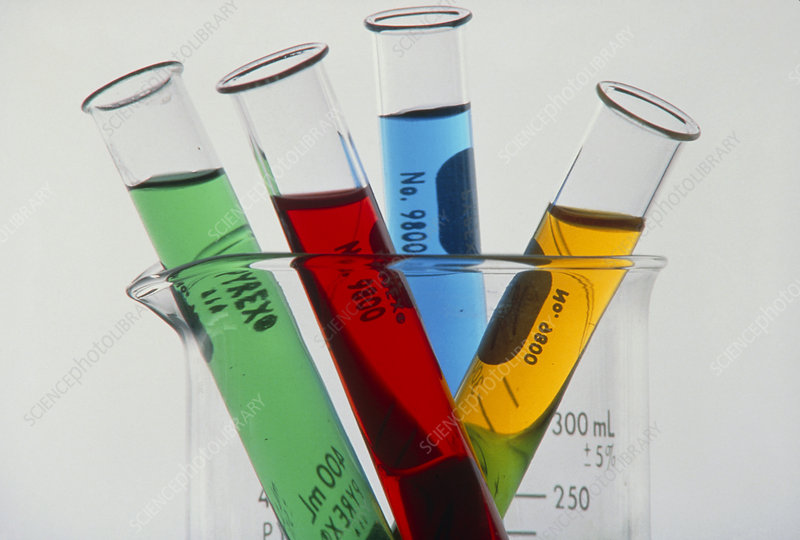 Test tubes with coloured solutions in beaker