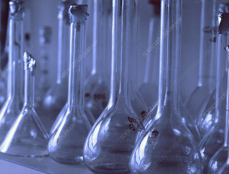 Volumetric flasks and a funnel in a laboratory