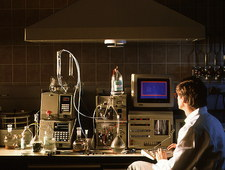 Scientist using HPLC equipment in a research lab