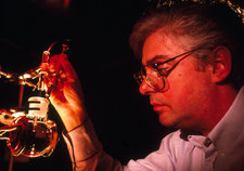 Scientist with sonoluminescence equipment