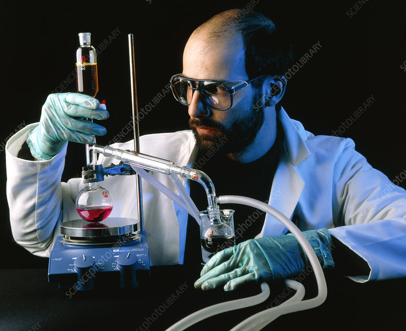 Chemist with distillation apparatus