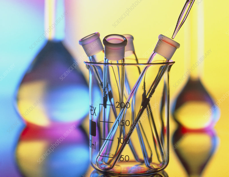 Test tubes in beaker with pipette and flasks