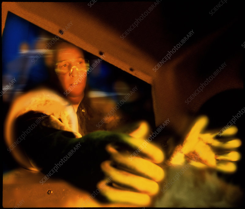 ale chemist transferring chemicals in a glove box