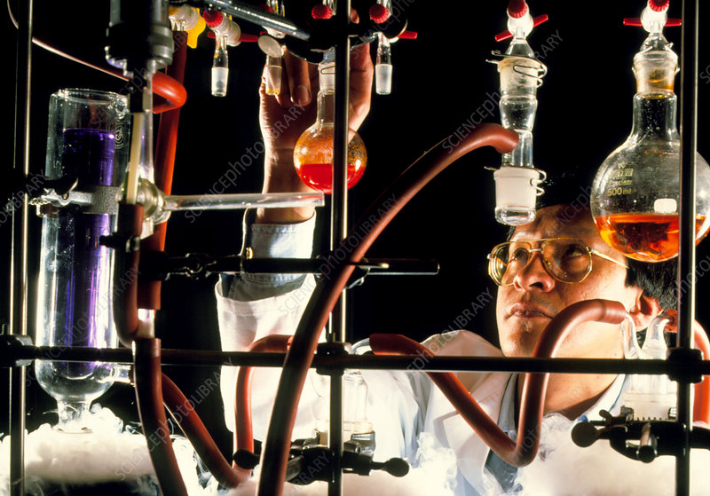 Chemist in laboratory conducting research
