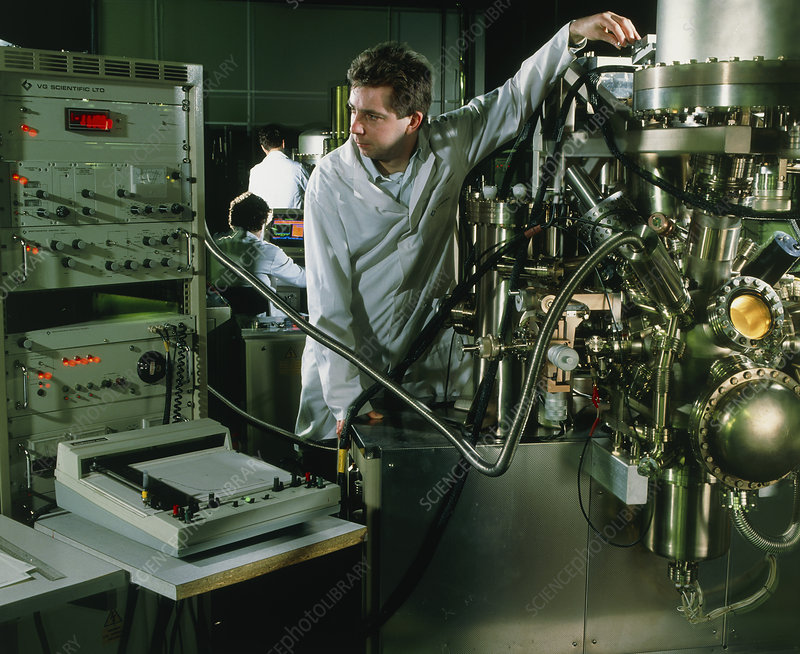 Scientist using a high resolution spectrometer