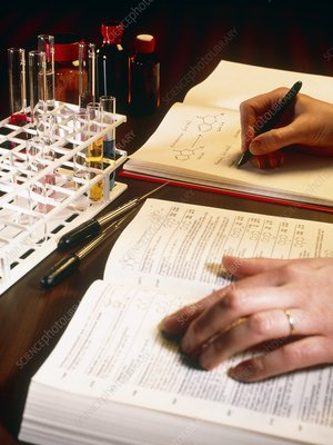 Hand writing in chemistry laboratory record book