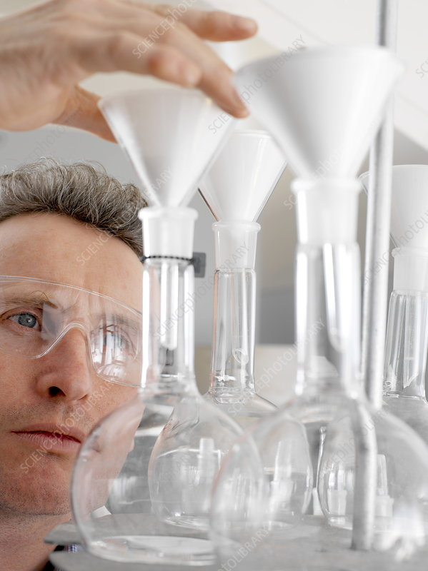 Chemist with glassware