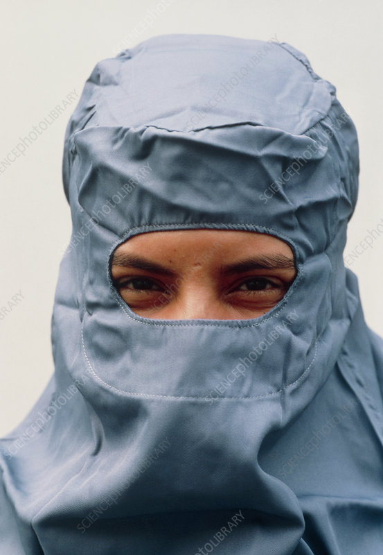 Pharmaceutical technician in clean room clothing