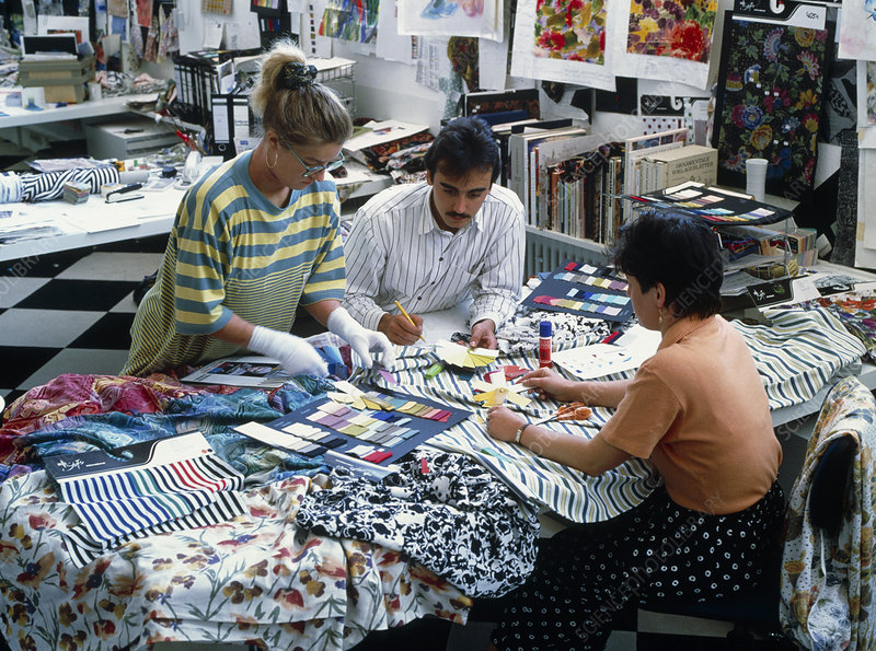 Textile designers at work with fabric samples