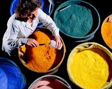 Worker with batches of ceramic pigments