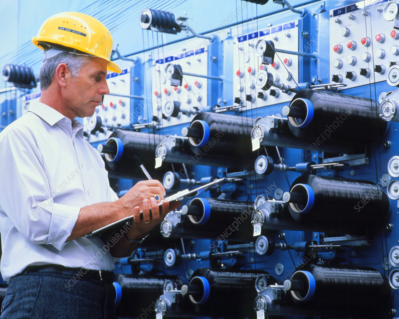 Technician with machinery for making carbon fibres