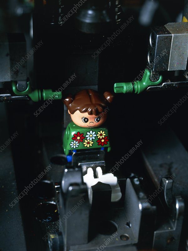 Lego doll in an assembly machine