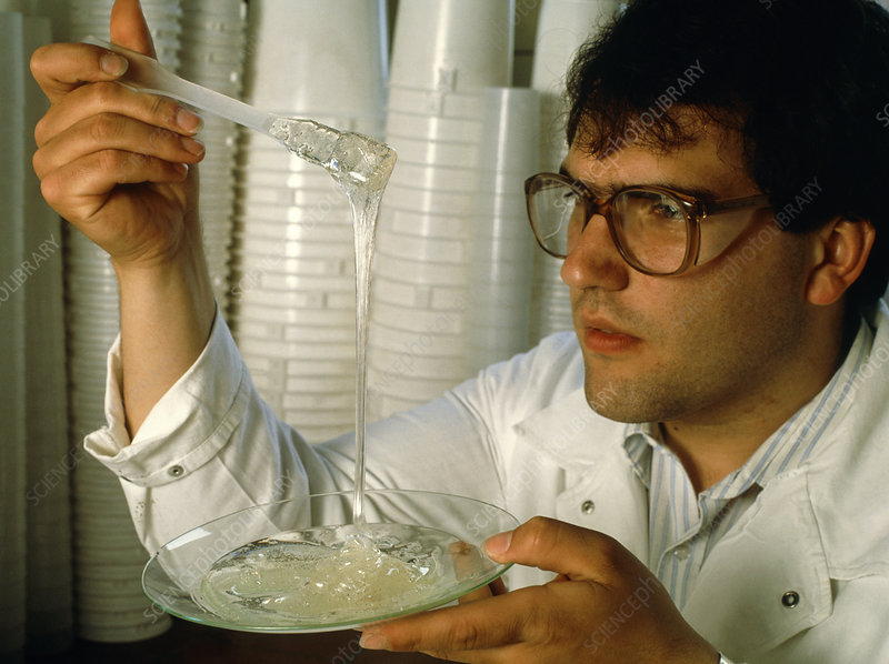 Scientist looks at a solidifying plastic resin