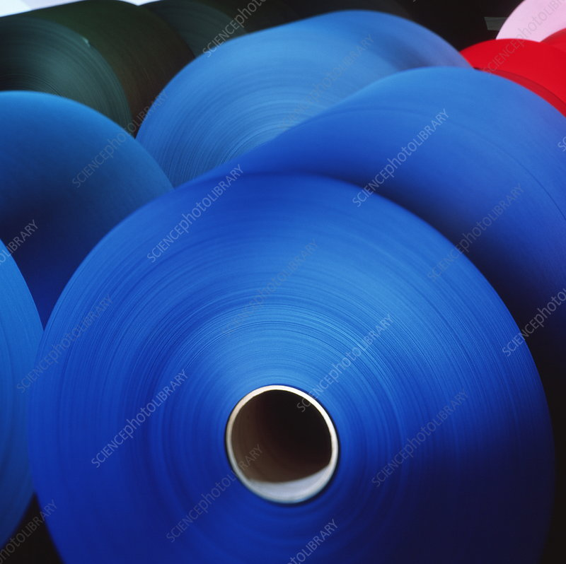 Rolls of coloured paper at a paper mill