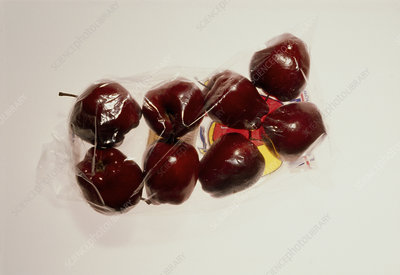 Eight red apples packaged