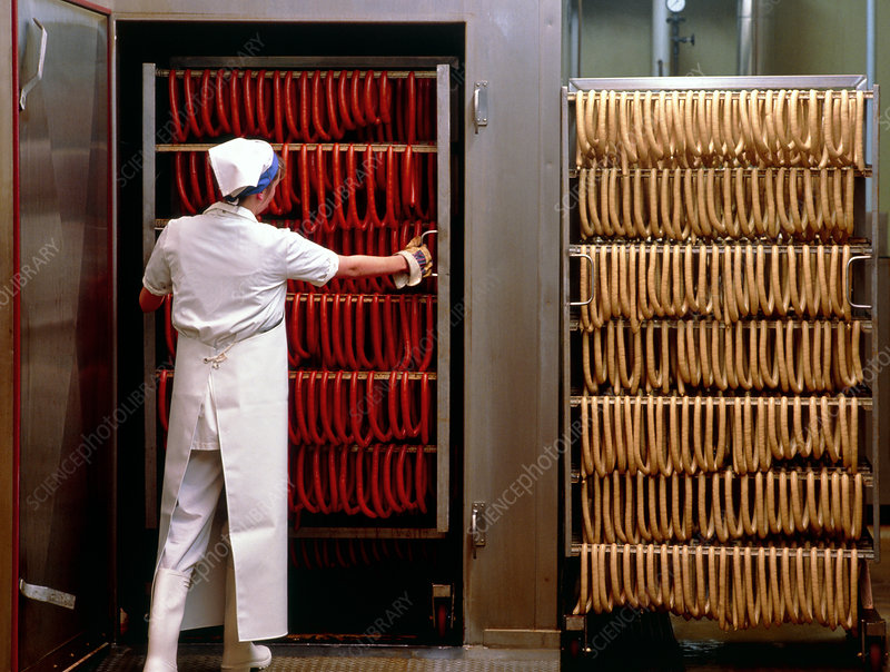 Sausages being removed from a smoking chamber.